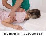 woman having chiropractic back... | Shutterstock . vector #1260389665