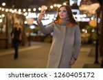 beautiful woman in a coat and... | Shutterstock . vector #1260405172
