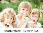 Happy Children Eating Ice Crea...