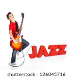 Boy plays  on electric guitar. The boy stands on the word of the juzz from the 3d text - isolated on white background - stock photo