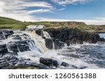 This is Dunseverick Falls on the Antrim Coast in Northern Ireland. It is a fresh water stream that runs into the ocean.  It is just a few miles away from the Giants Causway.