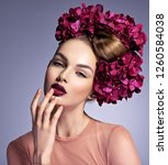 girl with a creative hairstyle... | Shutterstock . vector #1260584038