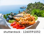 seafood platter. lunch by the...   Shutterstock . vector #1260591052