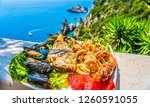 seafood platter. lunch by the... | Shutterstock . vector #1260591055