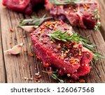 raw beef steak on a dark wooden ... | Shutterstock . vector #126067568