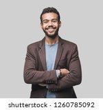portrait of handsome smiling... | Shutterstock . vector #1260785092