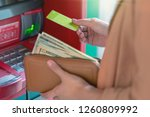 closeup woman withdrawing the... | Shutterstock . vector #1260809992