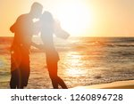 happy couple on nature in the... | Shutterstock . vector #1260896728