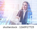 cheerful young businesswoman... | Shutterstock . vector #1260917725
