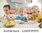 kids eating in kindergarten or... | Shutterstock . vector #1260939595