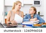 attractive woman helping her... | Shutterstock . vector #1260946018