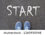 pair of feet on tarmac road... | Shutterstock . vector #1260950548