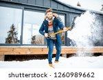 handsome man in winter clothes... | Shutterstock . vector #1260989662