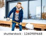 handsome man in winter clothes... | Shutterstock . vector #1260989668