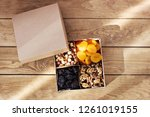a box of nuts and dried fruits... | Shutterstock . vector #1261019155
