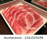 shabu pork  sliced raw pork in... | Shutterstock . vector #1261025698