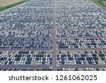aerial view of a big car park... | Shutterstock . vector #1261062025