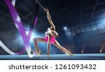 Small photo of Rhythmic gymnast in professional arena.