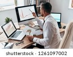 focusing on work. young... | Shutterstock . vector #1261097002