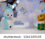 white snow man doll with gift... | Shutterstock . vector #1261105135