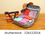 open silver suitcase with... | Shutterstock . vector #126112016
