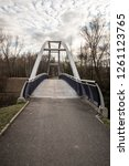 Small photo of bridge over Lucina river near Slezskoostravsky hrad castle in Ostrava city in Czech republic during nice autumn day with blue sky and clouds