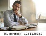 smart handsome businessman in... | Shutterstock . vector #1261135162