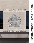 Small photo of Swansea, Wales, UK, June 30, 2018 : Swansea Crown Court sign in St Helen's Road which is the highest court of first instance in criminal cases