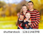 happy young family   Shutterstock . vector #1261146598