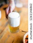 selective focus foam beer in... | Shutterstock . vector #1261146862