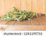 birch broom lies on the shelf... | Shutterstock . vector #1261195732