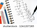 Small photo of Handwriting of mathematics quadratic equation formula on examination, practice, quiz or test in maths class. Solving exponential equations background concept.