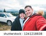happy tourists couple at peak...   Shutterstock . vector #1261218838
