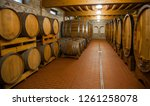 old wooden barrels with wine | Shutterstock . vector #1261258078