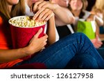 woman eating large container of ... | Shutterstock . vector #126127958