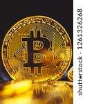 bitcoin coins on laptop... | Shutterstock . vector #1261326268