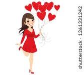 beautiful brunette girl holding ...   Shutterstock . vector #1261331242