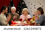 family praying before meals ... | Shutterstock . vector #1261340872