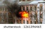 a fire in an apartment... | Shutterstock . vector #1261396465