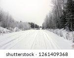 empty road with huge snow banks ... | Shutterstock . vector #1261409368