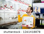 young smiling man choosing... | Shutterstock . vector #1261418878