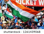 India Fans Wave Their National...