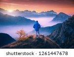 man on the mountain peak... | Shutterstock . vector #1261447678