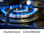 black gas stove with burning... | Shutterstock . vector #1261488202