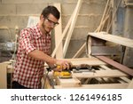busy and serious joiner holding ... | Shutterstock . vector #1261496185
