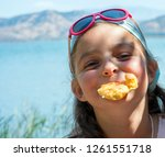 playful happy little girl... | Shutterstock . vector #1261551718