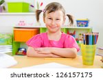 cute little girl drawing with... | Shutterstock . vector #126157175