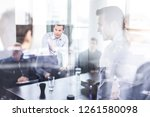 business team brainstorming on... | Shutterstock . vector #1261580098