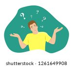 the surprised young man shrugs. ... | Shutterstock .eps vector #1261649908