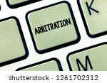 Small photo of Conceptual hand writing showing Arbitration. Business photo showcasing Use of an arbitrator to settle a dispute Mediation Negotiation
